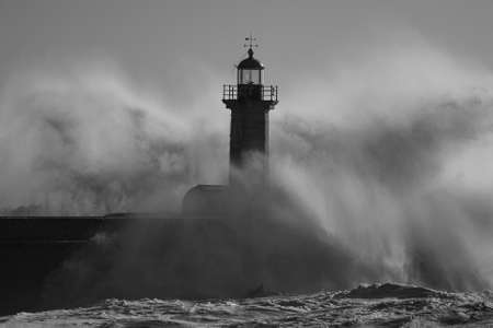 Sea storm at the Douro river old lighthouse. Used infrared filter.