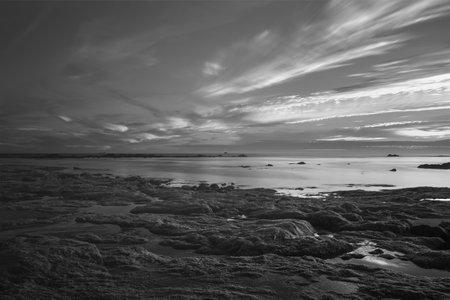Black and white infrared seascape at dusk. Northern Portuguese rocky coast. Archivio Fotografico