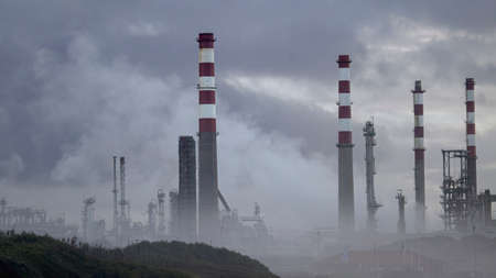 Part of big oil refinery in the middle of clouds and smog Archivio Fotografico