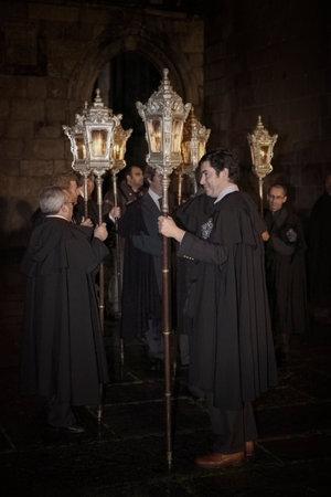 Braga, Portugal - April 1, 2010: Religious confraternity preparing for the Catholic night procession of the Ecce Homo (high ISO photo) Editoriali