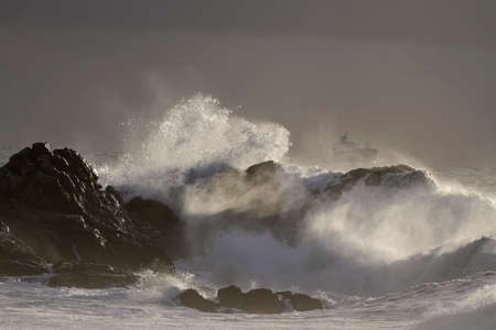 Sea storm at sunset. Northern Portuguese rocky coast.