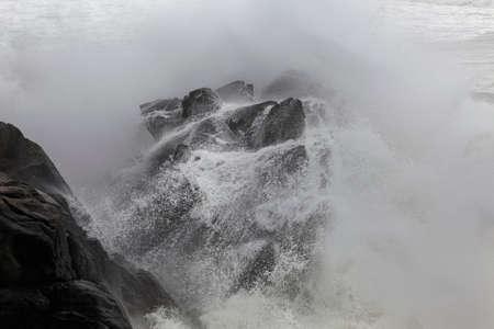 Floodeed big cliffs by stormy wave splash. Northern Portuguese rocky coast. Archivio Fotografico