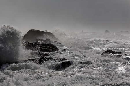 Winter dark seascape in a rough sea day seeing moisture. Northern Portuguese rocky coast.