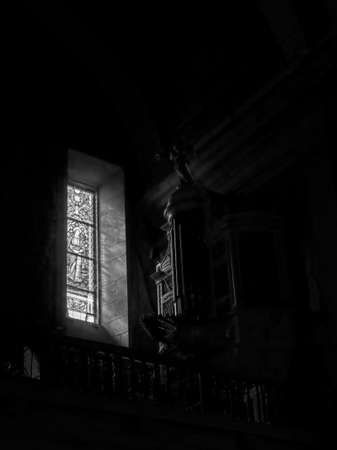 Porto, Portugal - March 4, 2015: Santo Antonio dos Congregados church organ illuminated by light filtered through a stained glass window. High ISO photo.