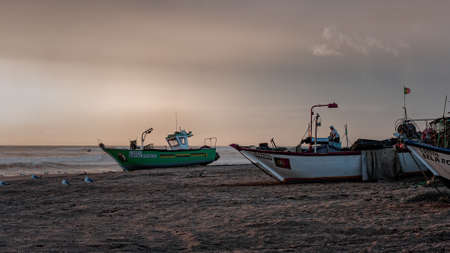 Angeiras, Portugal - September 21, 2006: Traditional fishing boats on the beach waiting for the tide at sunset