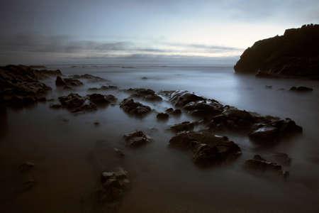 Rocky beach at dusk. Long exposure. Archivio Fotografico