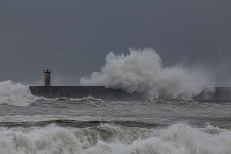 Leixoes harbor entrance and termimal of small tankers in a stormy late evening, north of Portugal.