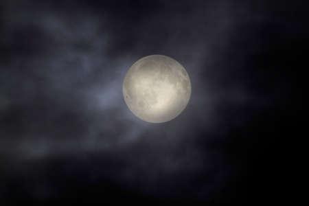 Overcast full moon night sky