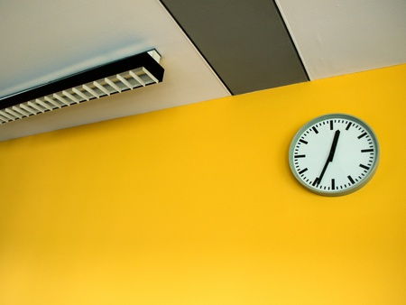Clock on yellow wall photo
