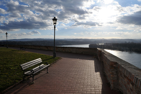 unreachable: The bench next to the wall with unreachable views of the Danube and Novi Sad from the Petrovaradin Fortress, Serbia