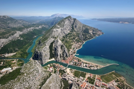 Aerial view - Omis city in Croatia  between Adriatic sea, mountain Omiska Dinara and river Cetina photo
