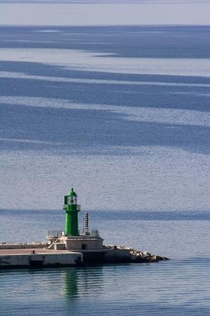 sureness: Lighthouse on breakwater in Split harbour
