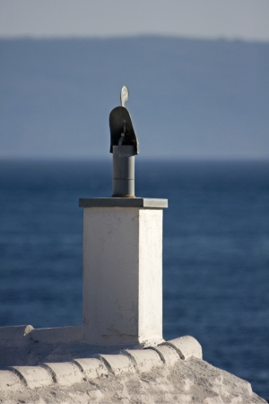 close up chimney: Chimney with metal cock  on top on the old mediterranean house in Croatia on island Brac