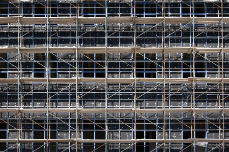 overbuilding: Scaffolding on a construction site of a new building