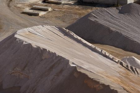 Heaps of aggregate in a rock quarry near Split in croatia photo