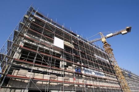 overbuilding: Ponteggi in un cantiere di un nuovo edificio Archivio Fotografico