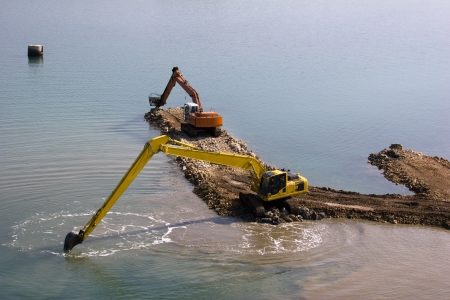 Two backhoes are deepen the seabed between islands Ugljan and Pasman in Croatia