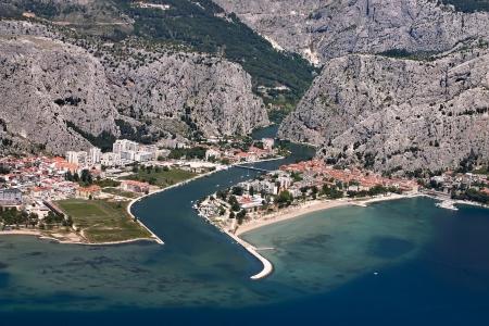 Aerial view - Omis city in Croatia  between Adriatic sea, mountain Omiska Dinara and river Cetina