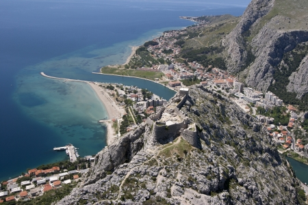 estuary: Aerial view - Omis city in Croatia  between Adriatic sea, mountain Omiska Dinara and river Cetina