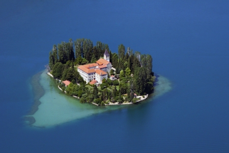 A small island with a Christian monastery on river Krka called Visovac, Croatia photo