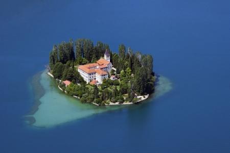 A small island with a Christian monastery on river Krka called Visovac, Croatia Фото со стока