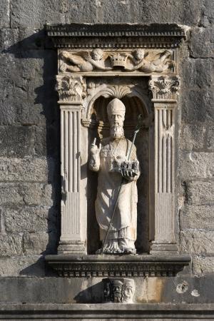 Statue of St  Blaise, Dubrovnik patron saint, on the wall above Pile gate Фото со стока
