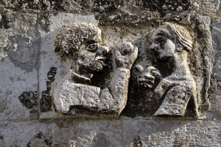 godlike: Adam takes apple from Eva, stone relief on the west wall of Diocletian palace in Split, Croatia Stock Photo
