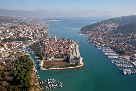 Trogir is a historic town and harbour on the Adriatic coast in Split-Dalmatia County, Croatia, The historic city of Trogir is situated on a small island between the Croatian mainland and the island of Ä?iovo.