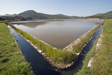 Ancient sea Saltern in town Ston on Peljesac peninsula in Croatia Stock Photo