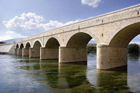 Renovated ancient stone arch bridge from 1905. over the river Cetina in Croatia
