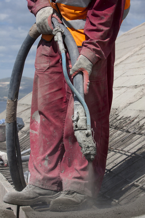 concrete surface finishing: Renewing roof of industrial hale with sprayed concrete Stock Photo