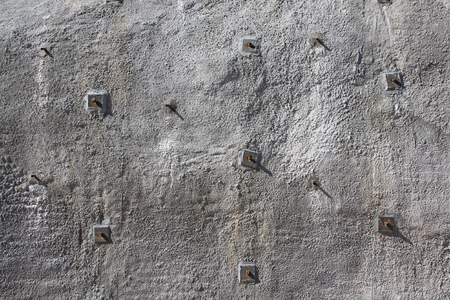 Part of concrete wall shotcrete wall, wall of sprayed concrete, stabilised with rock bolts
