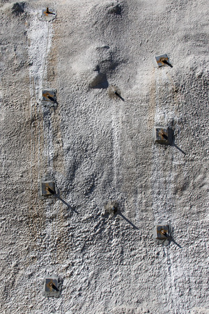 Part of concrete wall, shotcrete wall, wall of sprayed concrete, stabilised with rock bolts
