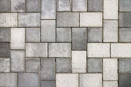 Shades of gray, part of urban street covered with gray concrete cubes