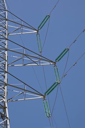 Part of transmission pylon with power lines and insulators Stock Photo