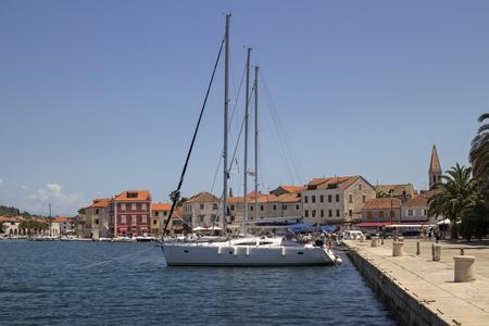Houses near the sea in  port of Starigrad on adriatic island Hvar in Croatia, Europe Фото со стока
