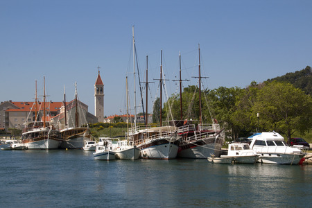 Tourist wooden sailing boats on the mouth of the river Cetina in the Adriatic Sea in town Omis, Croatia