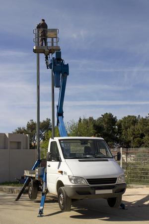 Aerial bucket truck, worker in truck mounted basket crane platform