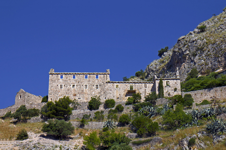 Ruins of abandoned catholic monastery near Murvica, Brac Island, Croatia Фото со стока