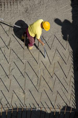 Construction worker vibrate concrete foundations
