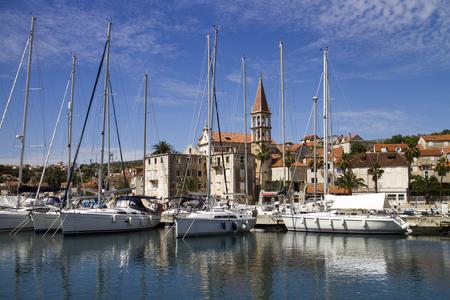 Marina and Church in Milna, village on west side of island Brac in Croatia Фото со стока