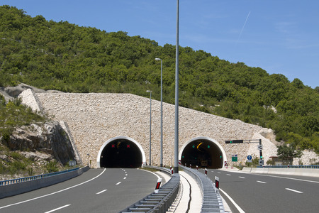 Stone build portal of tunnel on highway in Croatia