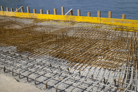 Concreting in the harbor, iron armature on the pier in the port
