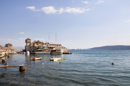 Wooden sailing boats in Kastel Gomilica one of seven settlement of town Kastela in Croatia Фото со стока