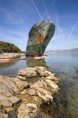 Old ruined ship aground on beach after shipwreck in the storm