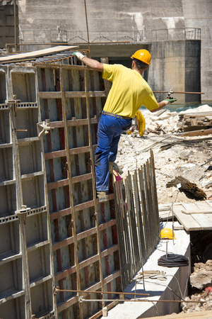 Working with prefabricated formwork on construction site