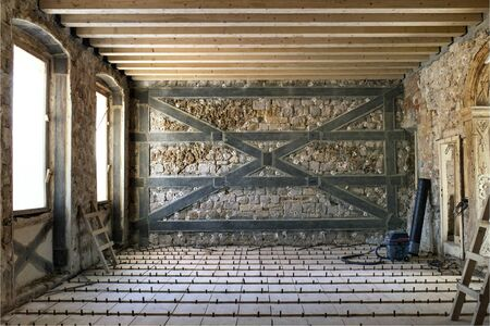 Renovation of old medieval house with injecting walls with special material and reinforcement with tapes of carbon fibers with special resin