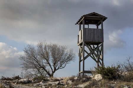 Old wooden fire protection watchtower on top of the hill Kozjak above of town Kastela in Croatia Фото со стока