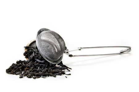 strainer: strainer with tea leafs
