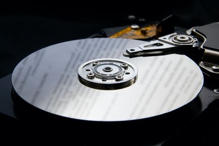 databank: hard disk drive on black background with reflection to represent data Stock Photo